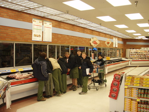 Scouts in the meat dept.  Like a dog on a bone.