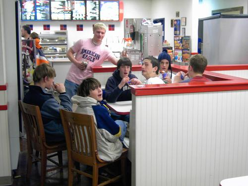 Power eating.  Left to right: Mason Smith, Matt Buller (standing), Jonathan Wingate, Garrett Hall, Matt Sangster, Bradley Beckner, Casey Fithen (facing away).